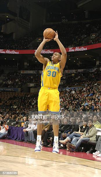 David West of the New Orleans/Oklahoma City Hornets shoots during the game against the Toronto Raptors on April 2 2006 at the Air Canada Centre in...