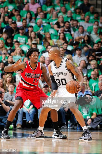 David West of the San Antonio Spurs handles the ball against Ed Davis of the Portland Trail Blazers on March 17 2016 at the ATT Center in San Antonio...