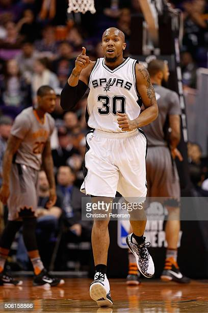 David West of the San Antonio Spurs reacts after scoring during the first half of the NBA game against the Phoenix Suns at Talking Stick Resort Arena...