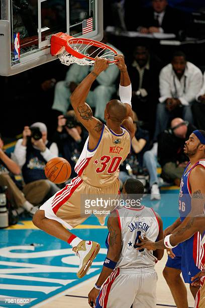 David West of the Western Conference AllStars dunks against Antawn Jamison of the Eastern Conference AllStars during the 2008 NBA AllStar Game at the...