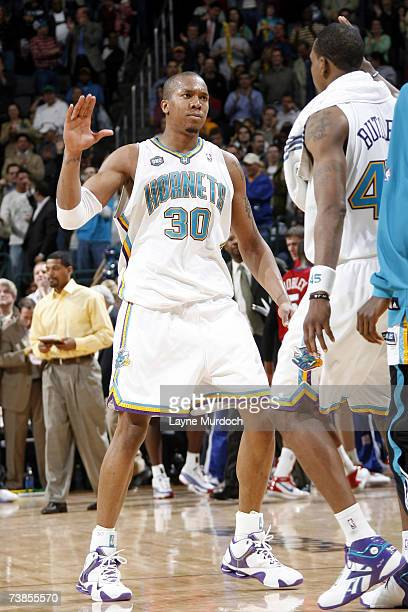 David West receives a high five from team mate Rasual Butler both of the New Orleans/Oklahoma City Hornets after making his free throws in overtime...
