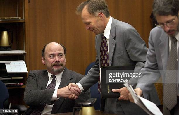 David Westerfield shakes hands with his attorney Robert Boyce after a pretrial hearing in San Diego CA court 25 April 2002 at which the District...