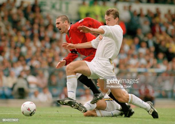 David Wetherall of Leeds United battles with Eric Cantona of Manchester United during an FA Carling Premiership match at Elland Road on September 07...