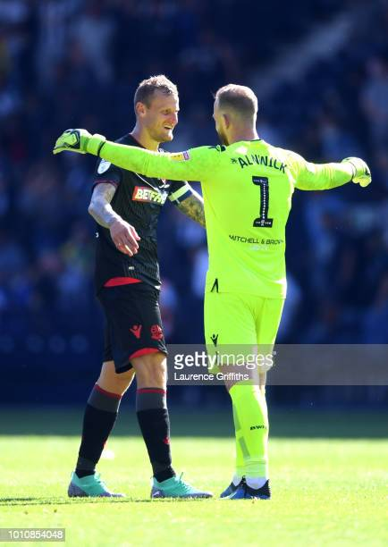 David Wheater and Ben Alnwick of Bolton Wanderers celebrate following the Sky Bet Championship match between West Bromwich Albion and Bolton...