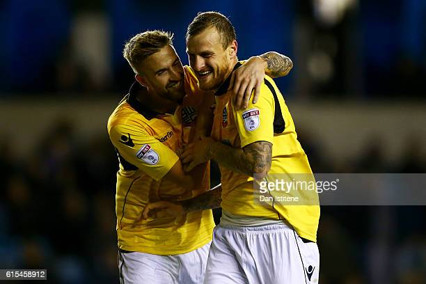 David Wheater of Bolton Wanderers celebrates with teammate Mark Beevers after scoring their second goal during the Sky Bet League One match between...
