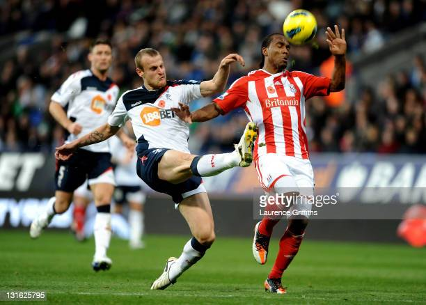 David Wheater of Bolton Wanderers challenges Cameron Jerome of Stoke City during the Barclays Premier League match between Bolton Wanderers and Stoke...
