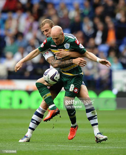 David Wheater of Bolton Wanderers gets to grips with Andy Johnson of Queens Park Rangers during the Sky Bet Championship match between Bolton...