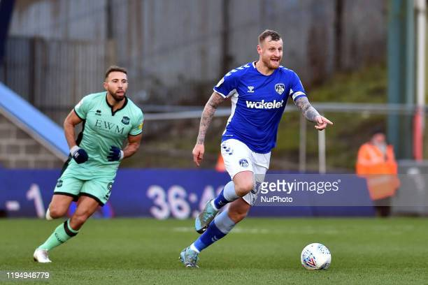 David Wheater of Oldham Athletic and Hallam Hope of Carlisle United in action during the Sky Bet League 2 match between Oldham Athletic and Carlisle...