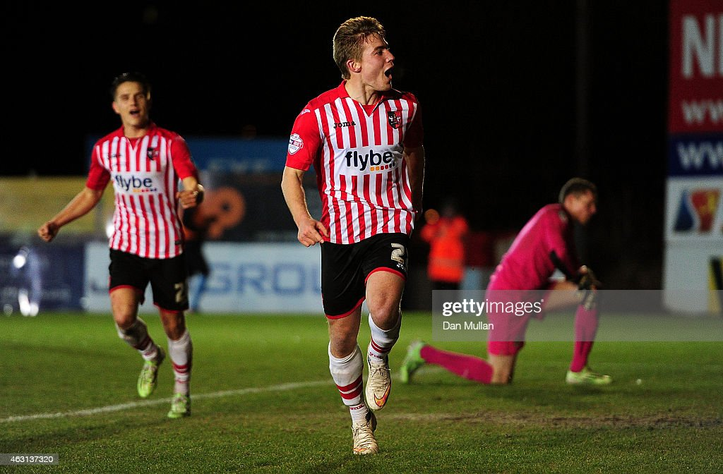 David Wheeler of Exeter City (C) celebrates scoring his side's second goal during the Sky Bet League Two match between Exeter City and Cambridge United at St. James Park on February 10, 2015 in Exeter, England.