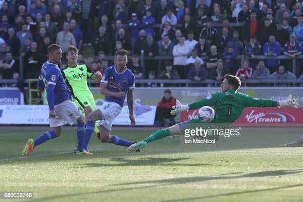 David Wheeler of Exeter City scores his team's third goal during the Sky Bet League Two match between Carlise United and Exeter City at Brunton Park...