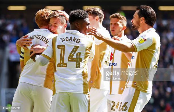 David Wheeler of Milton Keynes Dons celebrates with teammates after scoring his team's first goal during the Sky Bet League Two match between Milton...