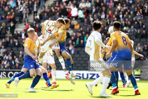 David Wheeler of Milton Keynes Dons scores his team's first goal during the Sky Bet League Two match between Milton Keynes Dons and Mansfield Town at...