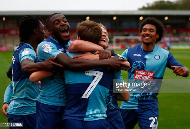 David Wheeler of Wycombe Wanderers is congratulated after scoring during the Sky Bet League One Play Off Semi-final 1st Leg match between Fleetwood...