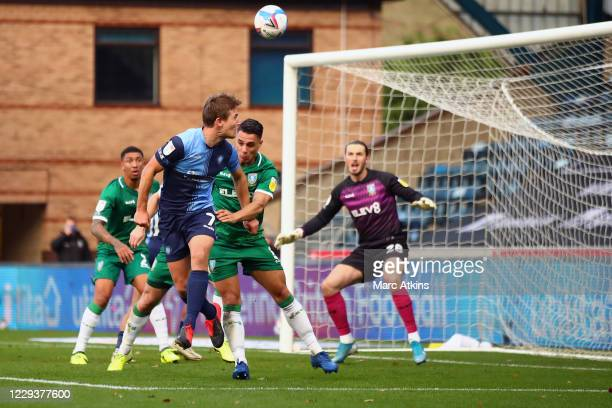 David Wheeler of Wycombe Wanderers scores the opening goal during the Sky Bet Championship match between Wycombe Wanderers and Sheffield Wednesday at...