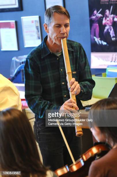 David Wheeler plays the shakuhaschi or Japanese flute with the Boulder High School orchestra in a rehearsal of Colors of a Bamboo Dream
