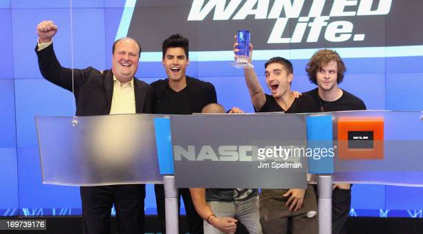 David Wicks Vice President of NASDAQ Marketsite singers Siva Kaneswaran Max George Tom Parker and Jay McGuiness of The Wanted ring the closing bell...