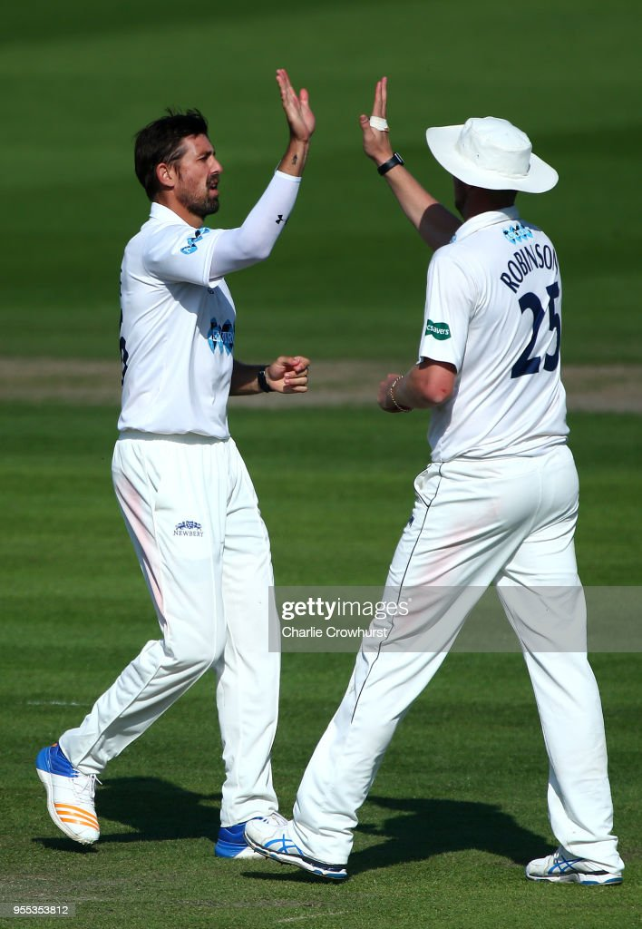 David Wiese of Sussex celebrates with Ollie Robinson after taking the wicket of Ollie Rayner of Middlesex during day three of the Specsavers County Championship: Division Two match between Sussex and Middlesex at The 1st Central County Ground on May 6, 2018 in Hove, England.