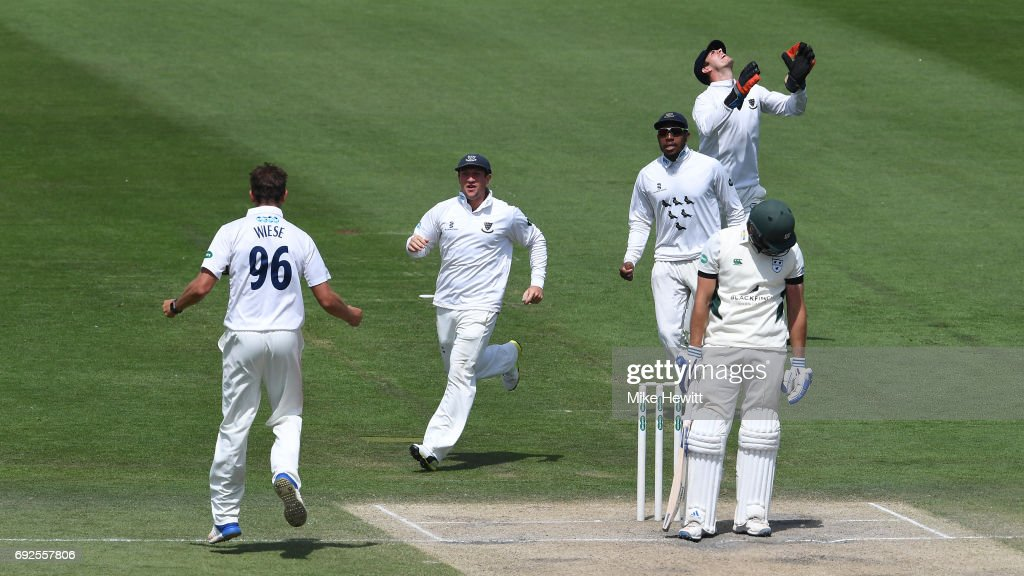 David Wiese of Sussex celebrates with team mates Harry Finch and Chris Jordan after dismissing Ross Whiteley, caught behind by Michael Burgess, during the fourth day of the Specsavers County Championship Division Two match between Sussex and Worcestershire at The 1st Central County Ground on June 5, 2017 in Hove, England.