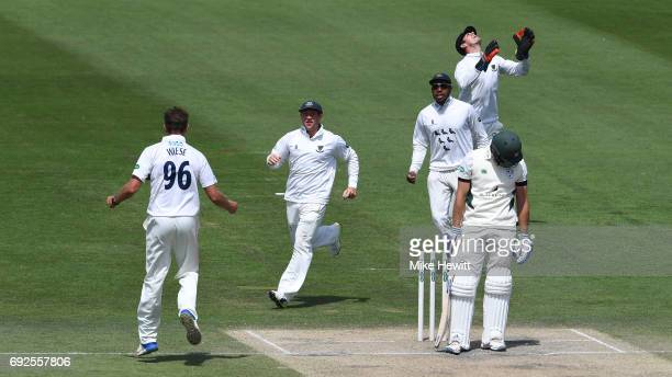 David Wiese of Sussex celebrates with team mates Harry Finch and Chris Jordan after dismissing Ross Whiteley caught behind by Michael Burgess during...
