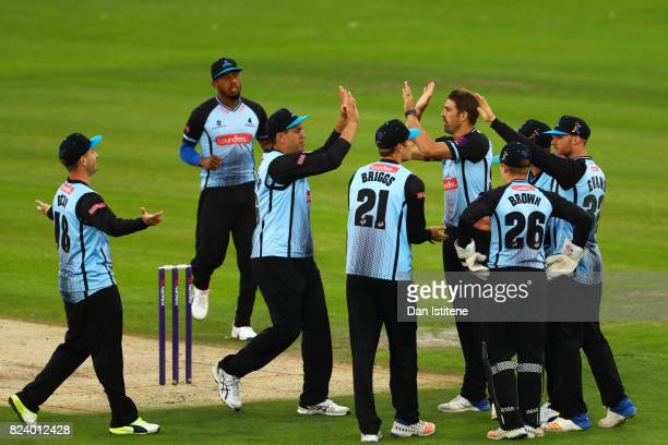 David Wiese of Sussex Sharks celebrates with teammates after claiming the wicket of Nick Gubbins during the NatWest T20 Blast South Group match...
