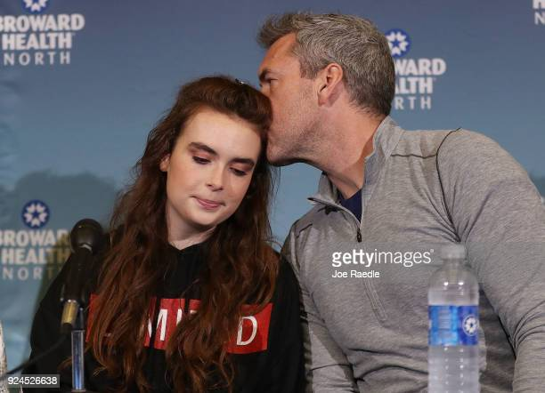 David Wilford kisses his daughter Maddy Wilford after she spoke to the media at Broward Health North after being shot multiple times during the mass...