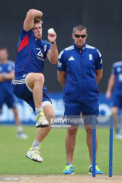 David Willey bowls under the watchful eye of coach Ashley Giles during the England Lions training session at The County Ground on August 19 2013 in...