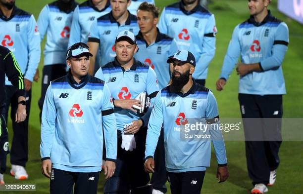 David Willey Jonny Bairstow and Moeen Ali lead England off the field after defeat in the Third One Day International between England and Ireland in...