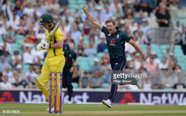 David Willey of England celebrates after dismissing Travis Head of Australia during the first Royal London OneDay International match between England...