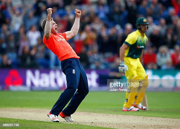 David Willey of England celebrates taking the wicket of Steve Smith of Australia during the NatWest T20 International match between England and...