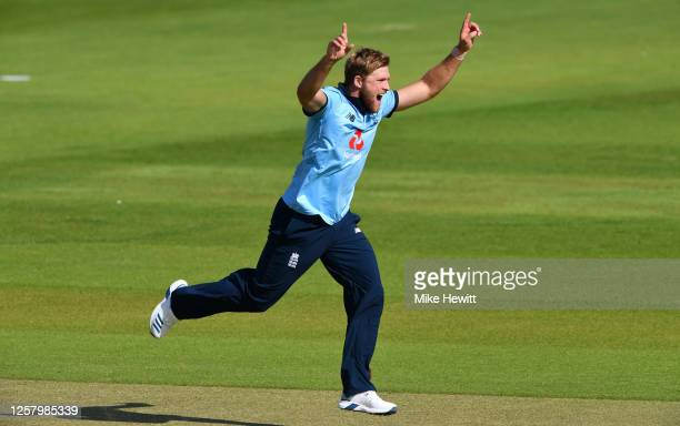 David Willey of England celebrates the wicket of Ben Duckett during a England One Day Squad Warm up match at The Ageas Bowl on July 24, 2020 in...