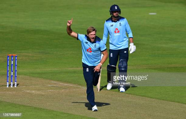 David Willey of England celebrates the wicket of Sam Billings during a England One Day Squad Warm up match at The Ageas Bowl on July 24, 2020 in...