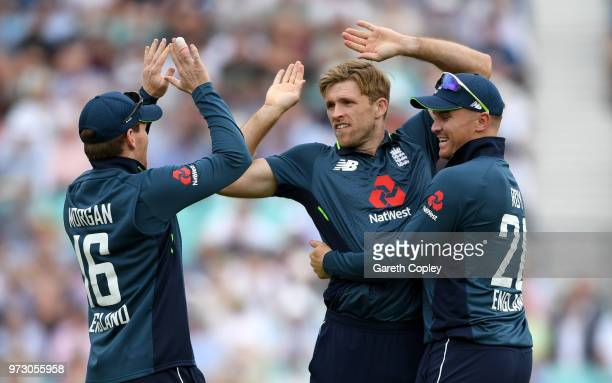 David Willey of England celebrates with Eoin Morgan and Jason Roy after dismissing Travis Head of Australia during the 1st Royal London ODI match...
