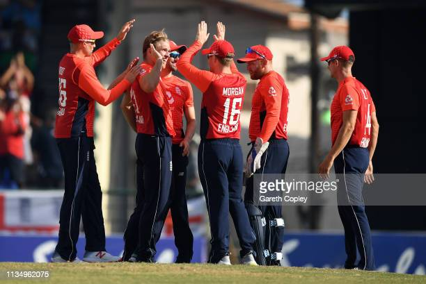 David Willey of England celebrates with teammates after dismissing Darren Bravo of the West Indies during the 3rd Twenty20 International match...
