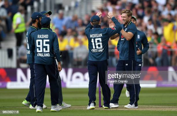 David Willey of England celebrates with teammates after dismissing Michael Neser of Australia during the 4th Royal London One Day International...