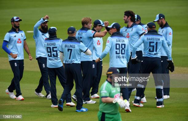 David Willey of England celebrates with teammates after taking the wicket of Paul Stirling of Ireland during the Second One Day International between...