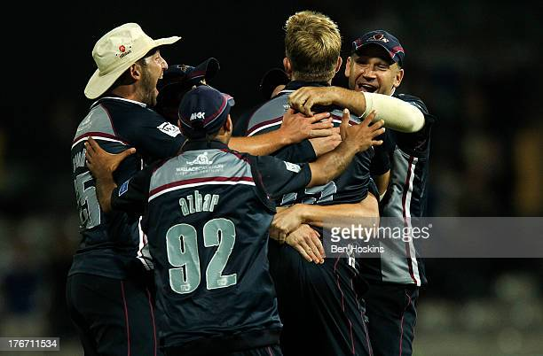 David Willey of Northamptonshire celebrates with team mates after taking the last wicket during The Friends Life T20 final between the Surrey Lions...