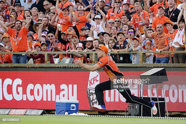 David Willey of the Scorchers takes a catch on the boundary off Chris Lynn of the Heat which was overturned by stepping on the rope during the Big...
