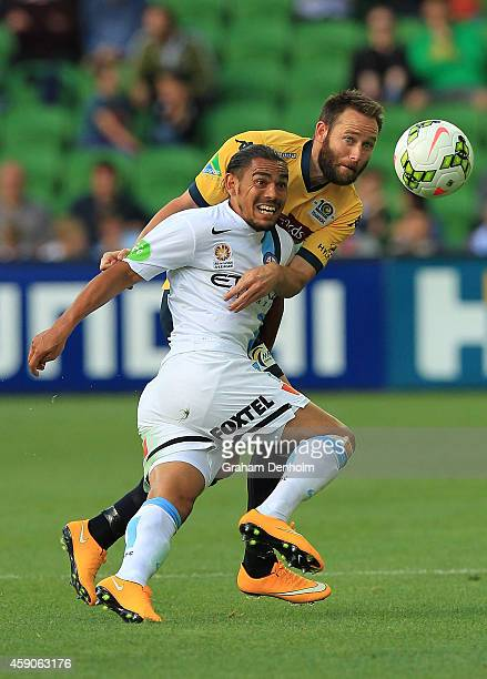 David Williams of Melbourne City controls the ball under pressure from Joshua Rose of Central Coast Mariners during the round six ALeague match...