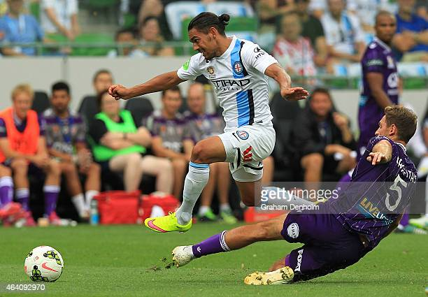 David Williams of Melbourne City evades the tackle of Rostyn Griffiths of Perth Glory during the round 18 ALeague match between Melbourne City FC and...