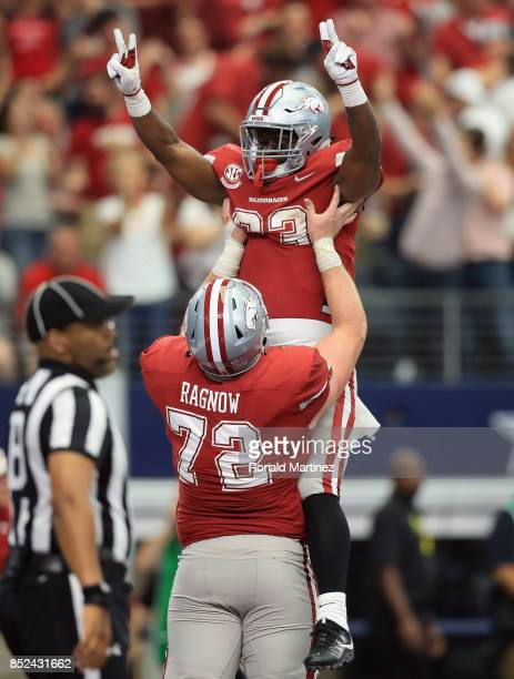 David Williams of the Arkansas Razorbacks celebrates his touchdown with Frank Ragnow in the second half against the Texas A&M Aggies at AT&T Stadium...