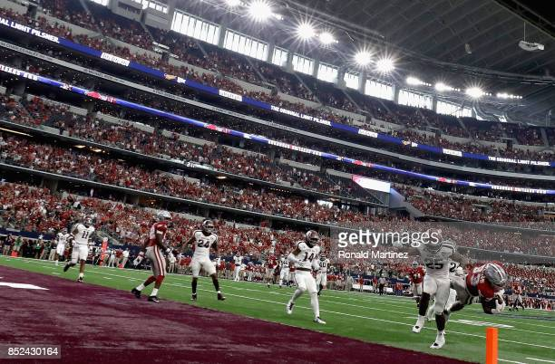David Williams of the Arkansas Razorbacks makes a pass reception in the third quarter against the Texas A&M Aggies at AT&T Stadium on September 23,...