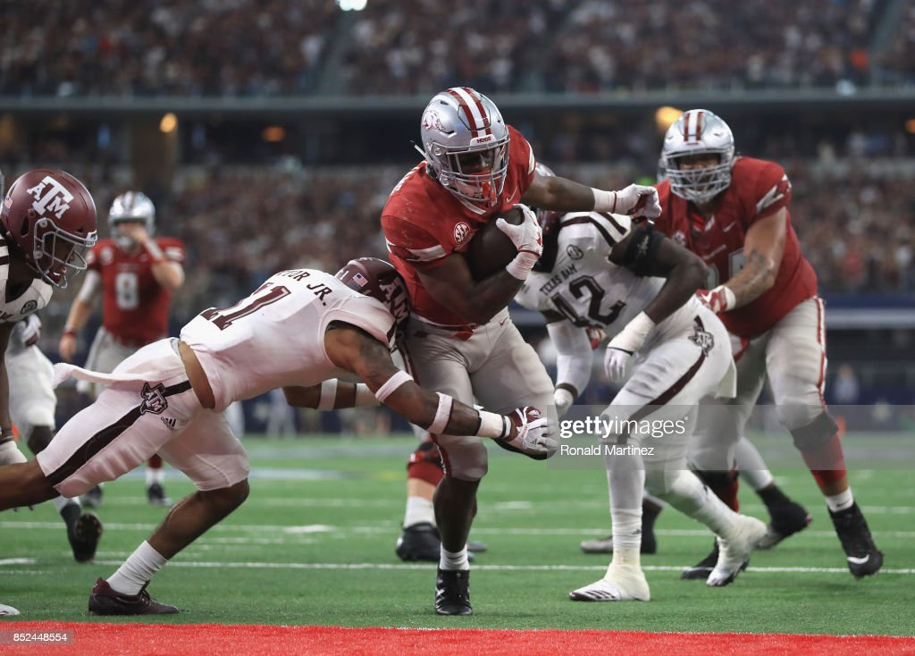David Williams #33 of the Arkansas Razorbacks runs for a touchdown in the fourth quarter against the Texas A&M Aggies at AT&T Stadium on September 23, 2017 in Arlington, Texas.