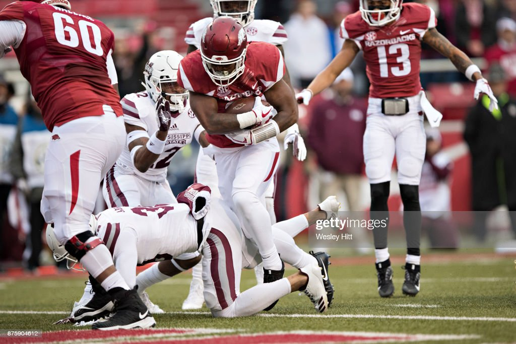 David Williams #33 of the Arkansas Razorbacks runs the ball in for a touchdown during a game against the Mississippi State Bulldogs at Razorback Stadium on November 18, 2017 in Fayetteville, Arkansas. The Bulldogs defeated the Razorbacks 28-21.