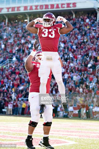 David Williams of the Arkansas Razorbacks shows his muscles after scoring a touchdown during a game against the Missouri Tigers at Razorback Stadium...