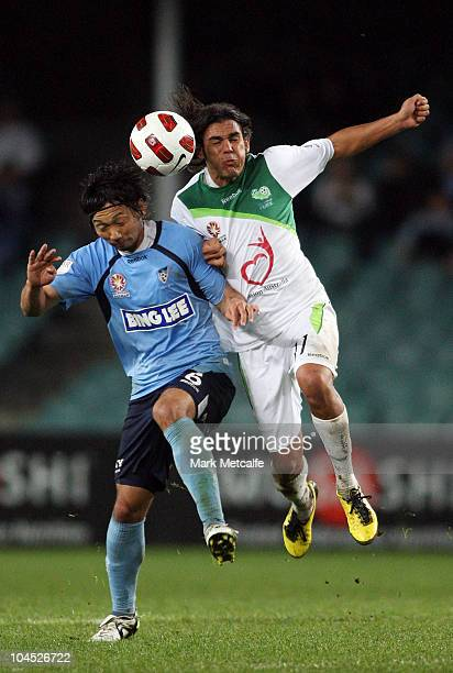David Williams of the Fury and Hirofumi Moriyasu of Sydney FC compete for the ball during the round eight ALeague match between Sydney FC and the...