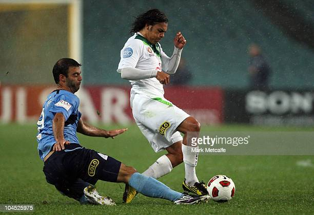 David Williams of the Fury is tackled by Bruno Cazarine of Sydney FC during the round eight ALeague match between Sydney FC and the North Queensland...