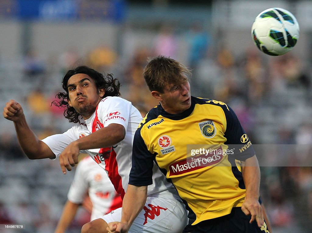David Williams of the Heart and Nick Fitzgerald of the Mariners contest the header during the round 27 A-League match between the Central Coast Marines and the Melbourne Heart at Bluetongue Stadium on March 30, 2013 in Gosford, Australia.