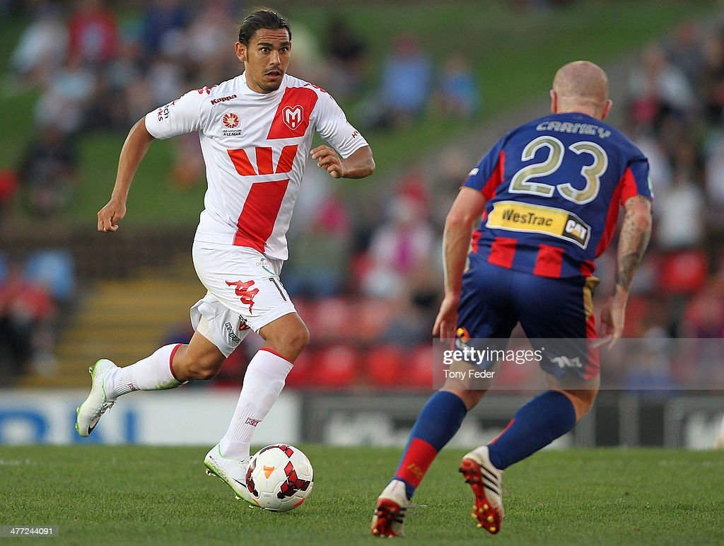David Williams of the Heart controls the ball ahead of Jets defence during the round 22 A-League match between the Newcastle Jets and Melbourne Heart at Hunter Stadium on March 8, 2014 in Newcastle, Australia.