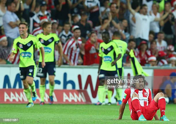 David Williams of the Heart sits dejected after Archie Thompson of the Victory scored during the round 12 ALeague match between the Melbourne Heart...