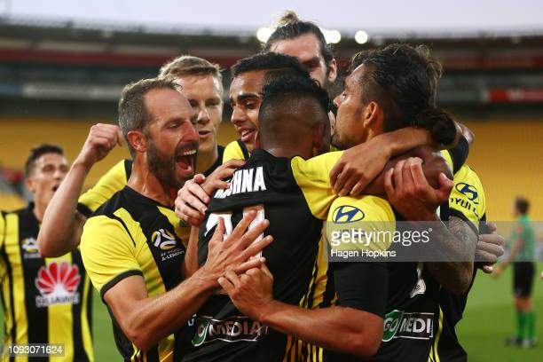 David Williams of the Phoenix celebrates with Roy Krishna and Andrew Durante after scoring a goal during the round 13 A-League match between the...